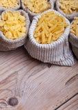 Assorted pasta in burlap bags Stock Photo