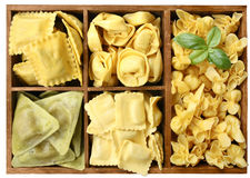 Assorted pasta with fillings in a wooden box Royalty Free Stock Photography