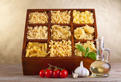 Assorted pasta mix in wooden box royalty free stock photos