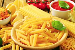Assorted pasta. And tomato puree royalty free stock photography
