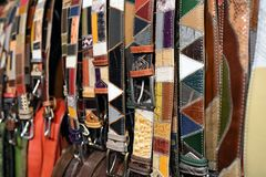 Assorted patterned handcrafted leather belts Stock Images