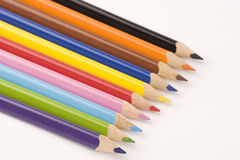 Assorted Pencils. Multiple assorted coloured pencils against a white background Stock Photos