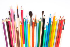 Assorted pencils and brushes. In a row on white background stock photo