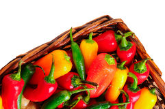Assorted peppers in basket Royalty Free Stock Photos