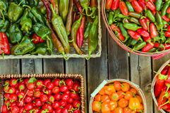 Assorted peppers in different baskets Royalty Free Stock Photography