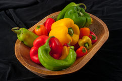 Assorted Peppers in  Wood Bowl Stock Photo