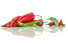 Assorted peppers. Peppers yellow, green and red colors and it's reflection on a white   background Stock Photos