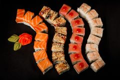 Free Assorted Philadelphia Sushi Rolls With Salmon, Eel, Tuna And Tiger Shrimp Stock Photography - 143144462