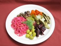 Assorted pickled vegetables. Appetizer - assorted pickled vegetables on the plate Royalty Free Stock Image