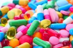 Assorted pills as background. Medical treatment. Assorted pills as background, closeup. Medical treatment stock image
