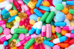 Assorted pills as background. Medical treatment. Assorted pills as background, top view. Medical treatment stock photos