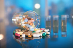 Assorted pills or capsules with medications on dark abstract bac Stock Image