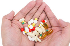 Assorted pills on hand Stock Images