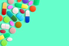 Free Assorted Pills In The Upper Left Corner On A Green Background Royalty Free Stock Image - 125344936