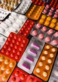 Assorted Pills in Packages Stock Photo