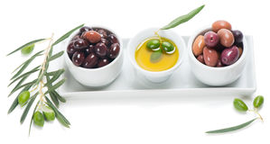 Assorted pitted olives with olive oil in a ceramic bowls Stock Photos