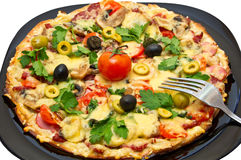 Assorted pizza. Pizza platter decorated with olives and tomatoes Royalty Free Stock Photo