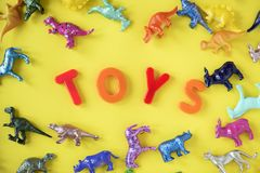 Assorted Plastic Toy on Yellow Surface Stock Photo