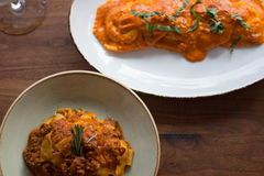 Assorted Plates of Pasta on a Table. Fresh made pasta dishes on a wooden table Stock Photography