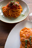 Assorted Plates of Pasta on a Table. Fresh made pasta dishes on a wooden table Stock Photo