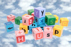 Assorted play blocks on clouds royalty free stock photos