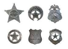 Assorted Police and Sheriff Badges. Vintage old sheriff, marshall, amd police badges isolated over white royalty free stock photo