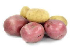 Assorted potatoes. Tubers of red and yellow potatoes over white background Royalty Free Stock Images