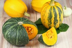 Assorted pumpkins and squashes on rustic wooden board Royalty Free Stock Photography