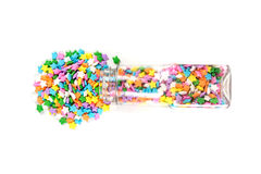 Assorted rainbow colored sprinkles and bottle Stock Images