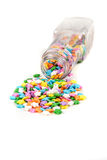 Assorted rainbow colored sprinkles and bottle Stock Photo