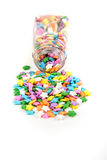 Assorted rainbow colored sprinkles and bottle Royalty Free Stock Images