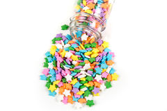 Assorted rainbow colored sprinkles and bottle Royalty Free Stock Photography