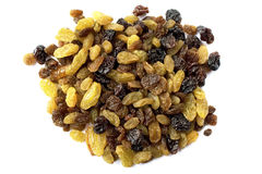 Assorted Raisins. Pile of assorted raisins isolated over a white background Stock Photography
