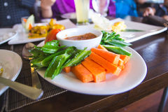 Assorted raw vegetables. Blanched in hot and served with homemade spicy and tangy shrimp paste dressing ( sambal belacan Stock Photography