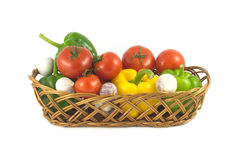 Assorted ripe vegetables in wicker basket isolated Stock Photography