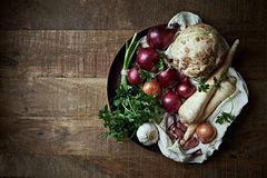 Assorted root vegetables and onions royalty free stock image