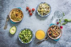 Assorted salads in bowls from above Royalty Free Stock Images