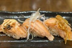 Assorted Salmon Suhi on black ceramic plate Stock Photo