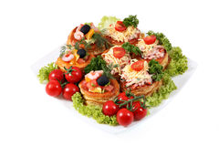 Assorted sandwiches with cheese, ham, shrimp and salmon on white Stock Image