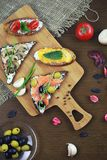Assorted sandwiches with different fillings, fish mushrooms and. Vegetablesr royalty free stock photos