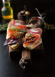 Assorted sandwiches with meat, smoked salmon, salami, olives and Royalty Free Stock Photography