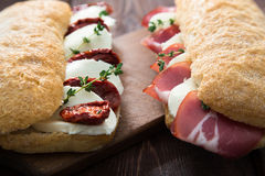 Assorted sandwiches. sandwich Caprese with mozzarella and sun-dr Royalty Free Stock Image