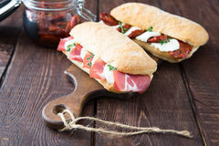 assorted sandwiches. sandwich Caprese with mozzarella and sun-dried tomatoes and ciabatta with ham royalty free stock photography
