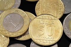 Assorted Saudi Arabian coins on a black background Stock Photos
