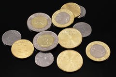 Assorted Saudi Arabian coins on a black background Royalty Free Stock Photo