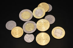 Assorted Saudi Arabian coins on a black background Royalty Free Stock Photos