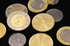 Assorted Saudi Arabian coins on a black background Royalty Free Stock Photography