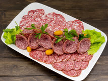 Assorted sausages sliced stock images