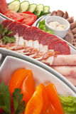 Assorted sausages and vegetables Stock Photo