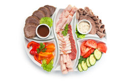 Assorted sausages and vegetables Royalty Free Stock Photography